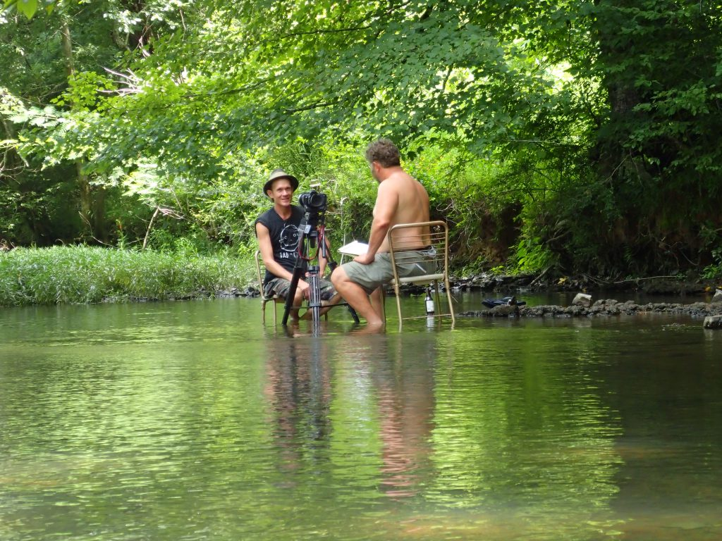 Modes interviews artist Butch Anthony sitting in Cypress Creek on a hot day in Florence, Alabama in 2016.